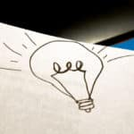 Light bulb on paper
